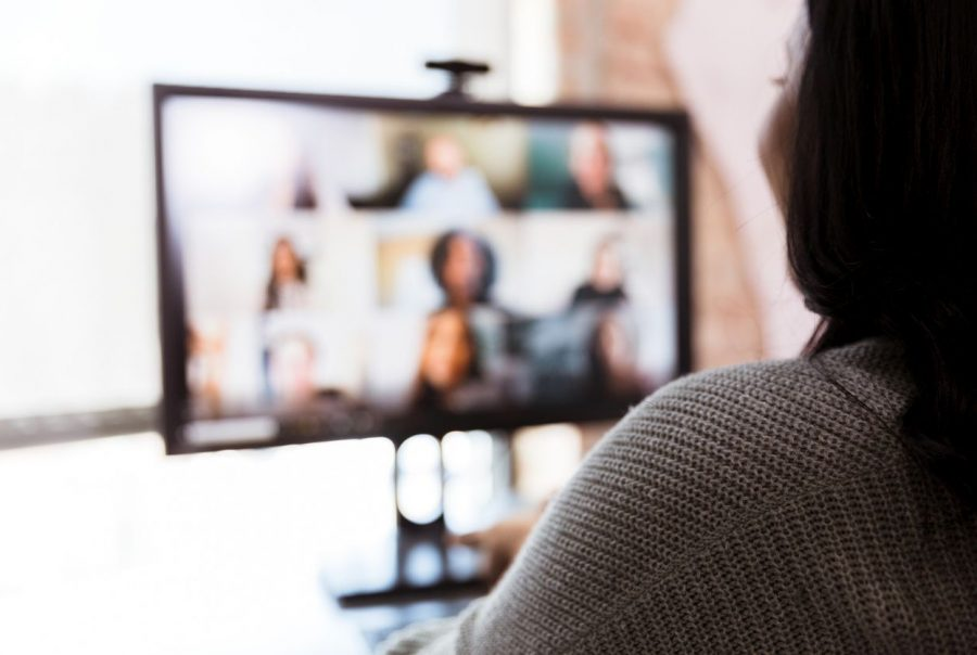 Woman and team meet via video conference